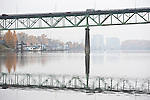 Landscapes of the Willamette River near the Sellwood Bridge with views of houseboats and downtown Portland.