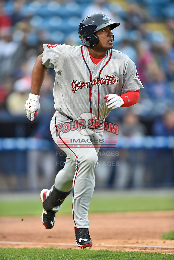 Greenville Drive left fielder Carlos Mesa (28) runs to first after hitting a home run during a game against the Asheville Tourists on April 16, 2015 in Asheville, North Carolina. The Tourists defeated the Drive 5-4. (Tony Farlow/Four Seam Images)