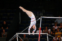 September 2, 2007; Stuttgart, Germany;  Beth Tweddle of Great Britain begins release move on uneven bars during team qualifications in women's artistic gymnastics at 2007 World Championships.  Photo by Copyright 2007 by Tom Theobald.