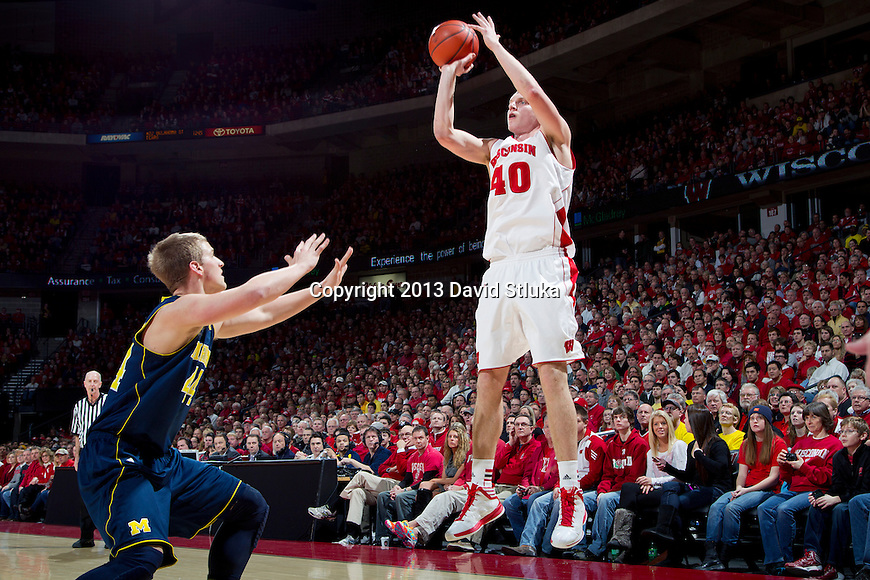 Wisconsin Badgers forward Jared Berggren (40) shoots the ball during a Big Ten Conference NCAA college basketball game against the Michigan Wolverines Saturday, February 9, 2013, in Madison, Wis. The Badgers won 65-62 (OT). (Photo by David Stluka)