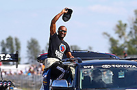 Aug. 17, 2013; Brainerd, MN, USA: NHRA top fuel dragster driver Antron Brown during qualifying for the Lucas Oil Nationals at Brainerd International Raceway. Mandatory Credit: Mark J. Rebilas-