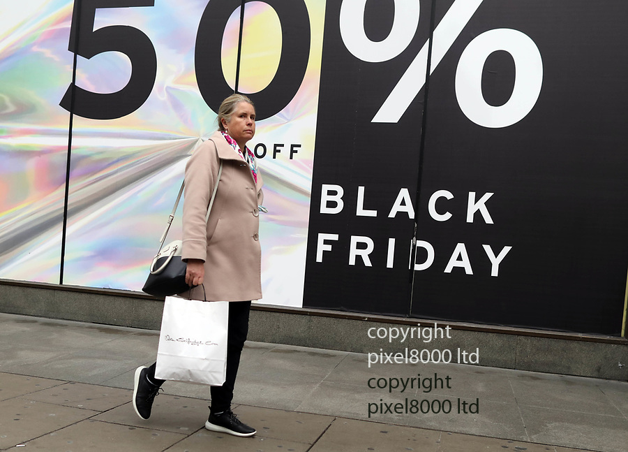 Pic shows: Black Friday sales<br /> <br /> Shoppers were largely underwhelmed today around Oxford Street but there were large queues outside Apple Shop before it opened.<br /> Apple store did not have official sale but were giving cash back on certain items<br /> <br /> <br /> <br /> <br /> pic by Gavin Rodgers/Pixel8000