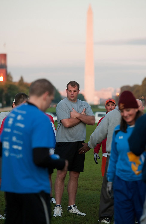 UNITED STATES - OCTOBER 04:  Rep. Jon Runyan, R-N.J., keeps his hands warm during a congressional football practice on the Mall in preparation for the upcoming game between members of Congress and the Capitol Police.  (Photo By Tom Williams/Roll Call)
