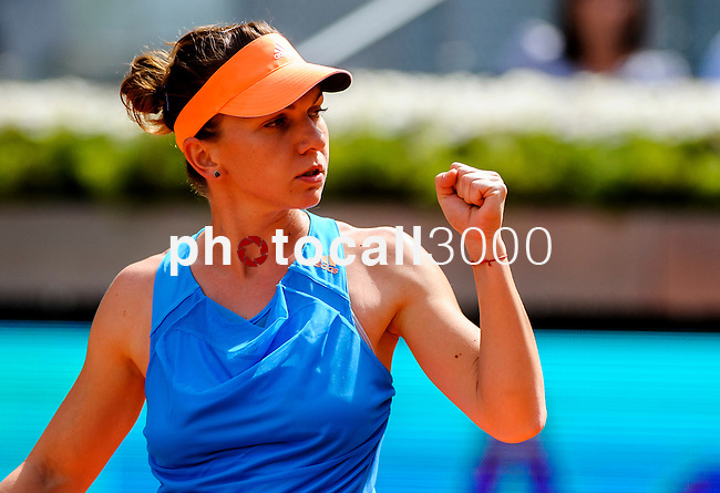 "Romanian tennis player Simona Halep celebrates after winning a point during his women's singles final tennis match against Russian tennis player Maria Sharapova at the Madrid Masters at the ""Caja Magica"" sports complex in Madrid on May 11, 2014.<br /> <br /> Photocall3000/Daniel Calleja"