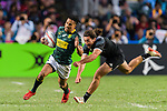 Jordan Bunce of New Zealand (R) tries to put a tackle on Selvyn Davids of South Africa (L) during the HSBC Hong Kong Sevens 2018 Bronze Medal Final match between South Africa and New Zealand on 08 April 2018 in Hong Kong, Hong Kong. Photo by Marcio Rodrigo Machado / Power Sport Images