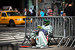 A man disguised as liberty statue takes a break during his work at Times Square in New York, United States. 5/4/2012.  Photo by Eduardo Munoz Alvarez / VIEWpress.