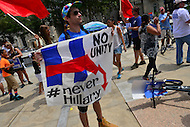 "Philadelphia, PA - July 26, 2016: Mike Mazur of Chicago holds a never Hillary sign at a ""Bernie or Bust"" rally across from City Hall during the Democratic National Convention in Philadelphia, PA, July 26, 2016  (Photo by Don Baxter/Media Images International)"