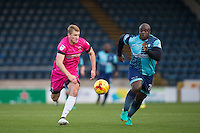 Adebayo Akinfenwa of Wycombe Wanderers & Scott Harrison of Hartlepool United chase down the ball  during the Sky Bet League 2 match between Wycombe Wanderers and Hartlepool United at Adams Park, High Wycombe, England on 26 November 2016. Photo by PRiME Media Images.