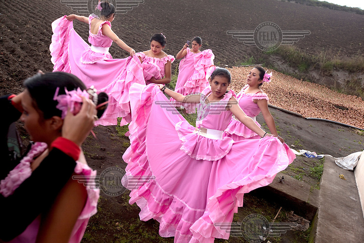 Young women dress in Spanish dresses for the parade of the fiesta of Mocha.