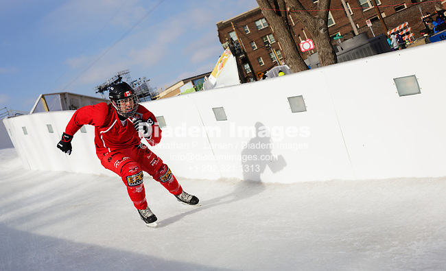 ST. PAUL, MN - JANUARY 25:  A competitor in the Red Bull Crashed Ice competition skates down the track during the international shoot-out and elimination round on January 25, 2013 in St. Paul, Minnesota, one of the many events at the St. Paul Winter Carnival.  Editorial use only.  Commercial use prohibited.  (Photograph by Jonathan Paul Larsen)