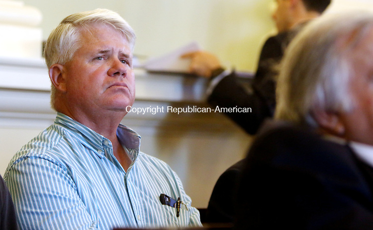 WATERBURY CT. 18 July 2017-071817SV01-Steve Francois, project engineer for I-84 Constructors, listens to proposed zoning changes during the Zoning Commission meeting in Waterbury Tuesday. The I-84 Constructor's submitted an application for an earth-excavation permit to use old quarry on Pearl Lake Road for a rock crushing operation and storage facility.<br /> Steven Valenti Republican-American