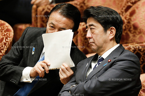 February 12, 2013, Tokyo, Japan - Japan's Prime Minister Shinzo Abe, right, confers with Finance Minister Taro Aso during a question-and-answer session of the Diet lower house Budget Committee in Tokyo on Tuesday, February 12, 2013. (Photo by AFLO)