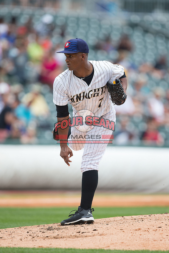 Charlotte Knights starting pitcher Miguel Chalas (7) follows through on his delivery against the Gwinnett Braves at BB&T BallPark on July 3, 2015 in Charlotte, North Carolina.  The Braves defeated the Knights 11-4 in game one of a day-night double header.  (Brian Westerholt/Four Seam Images)