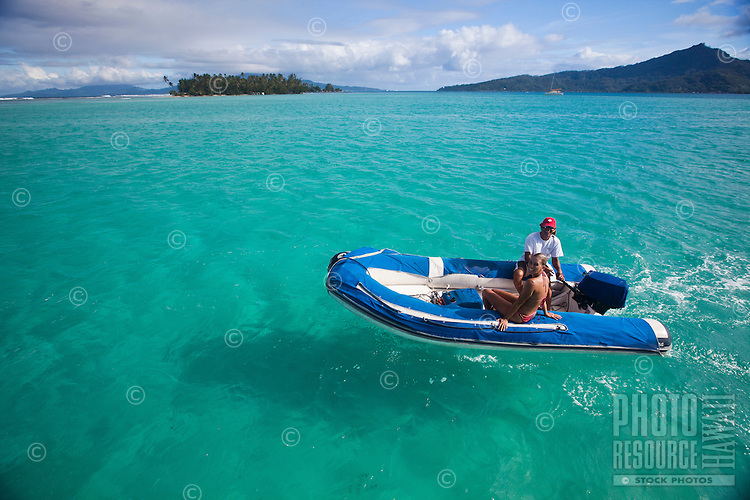 Couple in dinghy in Tahaa's lagoon