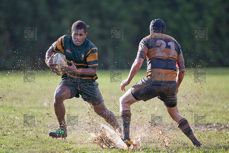 Peni Buakula looks to run around Jon Harbraken. Counties Manukau Premier Club Rugby game between Pukekohe and Bombay played in very wet conditions at Colin Lawrie Fields Pukekohe on Saturday 18th June 2011. Pukekohe won 61 - 0 after leading 31 - 0 at halftime.