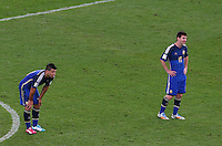 Sergio Aguero and Lionel Messi of Argentina show a look of dejection after Mario Goetze of Germany scores the winning goal
