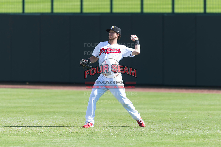 Glendale Desert Dogs right fielder Connor Marabell (4), of the Cleveland Indians organization, throws to the infield during an Arizona Fall League game against the Scottsdale Scorpions at Camelback Ranch on October 16, 2018 in Glendale, Arizona. Scottsdale defeated Glendale 6-1. (Zachary Lucy/Four Seam Images)