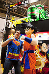 """A visitor poses for a picture with Goku (Son Goku) the main protagonist of the Japanese manga series Dragon Ball at the Anime Japan 2015 on March 21, 2015 in Tokyo, Japan. Anime Japan 2015 brings together all aspects of the """"anime"""" industry offering an opportunity for visitors get close to creators, voice actors, idol groups, and cosplayers, and to learn about the industry. This is the second year that the exhibition is being held at Tokyo Big Sight. Organizers estimated that approximately 100,000 visitors attended in 2014 and similar huge numbers are expected this year. The exhibition is open on March 21st and 22nd. (Photo by Rodrigo Reyes Marin/AFLO)"""