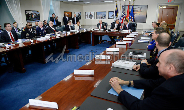 United States President Barack Obama and Defense Secretary Ash Carter (R) hold a national security council meeting on the counter-ISIL campaign at the Pentagon December 14, 2015 in Arlington, Virginia. During the meeting President Obama received an update from his national security team and discussed ways to further enhance the campaign to degrade and destroy the terrorist group. Photo Credit: Olivier Douliery/CNP/AdMedia
