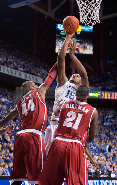 University of Kentucky freshman forward DeMarcus Cousins shoots a layup over Alabama's Chris Hines and Senario Hillman in UK's 66-55 win over Alabama on Tuesday, Feb. 9, 2010 in Rupp Arena...Photo by Ed Matthews | Staff