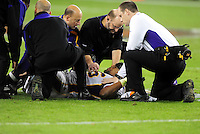 Dec 6, 2009; Glendale, AZ, USA; Minnesota Vikings head coach Brad Childress (center) talks to linebacker E.J. Henderson as he lays on the ground after suffering an injury in the fourth quarter against the Arizona Cardinals at University of Phoenix Stadium. The Cardinals defeated the Vikings 30-17. Mandatory Credit: Mark J. Rebilas-