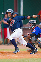Jhonatan Arias #7 of the Elizabethton Twins follows through on his swing against the Kingsport Mets at Joe O'Brien Field August 14, 2010, in Elizabethton, Tennessee.  Photo by Brian Westerholt / Four Seam Images