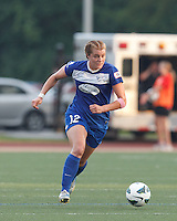 Boston Breakers forward Katie Schoepfer (12) brings the ball forward.  In a National Women's Soccer League (NWSL) match, Seattle Reign FC (white) defeated Boston Breakers (blue), 2-1, at Dilboy Stadium on June 26, 2013.