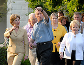 Washington, D.C. - June 5, 2008 -- United States President George W. Bush points towards the stage as he and first lady Laura Bush, left, Vice President Dick Cheney and Lynne Cheney, in white at far right at the Congressional Picnic on the South Lawn of The White House on Thursday, June 5, 2008.<br /> Credit: Ron Sachs / Pool via CNP