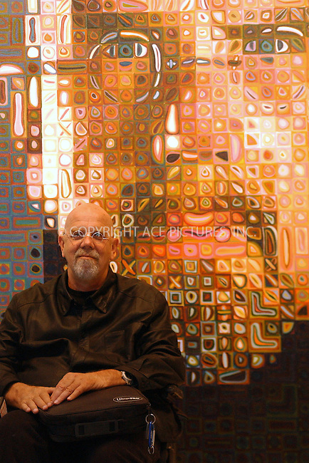 WWW.ACEPIXS.COM . . . . . ....NEW YORK, MAY 10, 2005....Chuck Close poses in front of a self portrait from his new show at Pace Wildenstein.....Please byline: KRISTIN CALLAHAN - ACE PICTURES.. . . . . . ..Ace Pictures, Inc:  ..Craig Ashby (212) 243-8787..e-mail: picturedesk@acepixs.com..web: http://www.acepixs.com