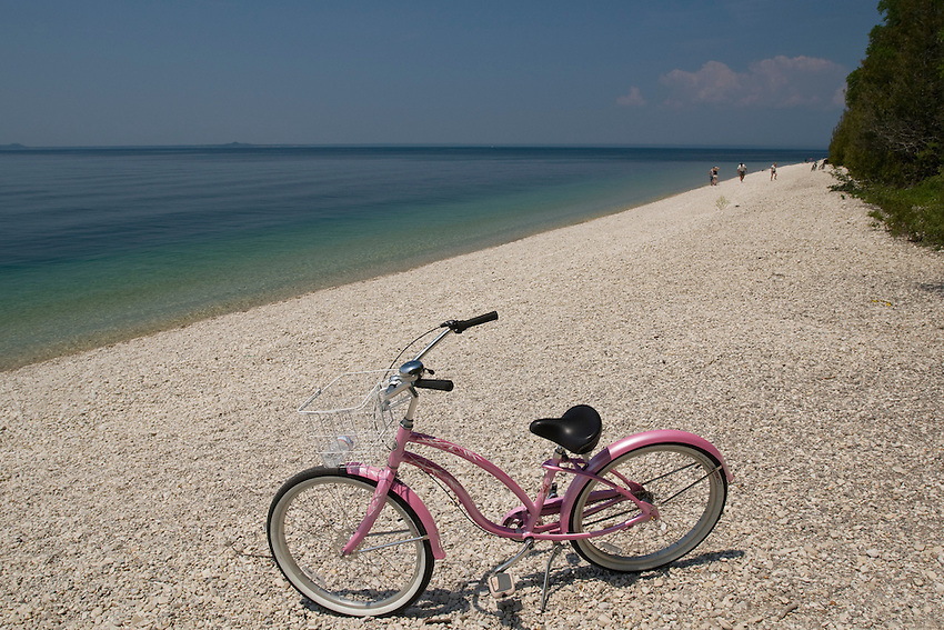 A pink bike on a Lake Huron beach at Mackinac Island in Michigan.