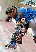 Washington, D.C. - April 3, 2005 -- New York Mets  catcher Ramon Castro (11) prepares his shin guards prior to the exhibition game against the Washington Nationals at RFK Stadium in Washington, D.C. on April 3, 2005..Credit: Ron Sachs / CNP.(RESTRICTION: NO New York or New Jersey Newspapers or newspapers within a 75 mile radius of New York City)