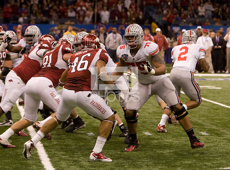 Mike Adams of Ohio State in action against Arkansas during 77th Annual Allstate Sugar Bowl Classic at Louisiana Superdome in New Orleans, Louisiana on January 4th, 2011.  Ohio State defeated Arkansas, 31-26.