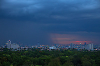 Black clouds and the last light from the sunset a massive Rain storm over Metro Manila, Philippines  the onset of the Monsoon Season,
