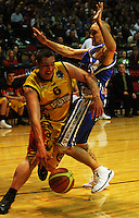 Ray Cameron goes around Lindsay Tait during game two of the NBL Final basketball match between the Wellington Saints and Waikato Pistons at TSB Bank Arena, Wellington, New Zealand on Friday 20 June 2008. Photo: Dave Lintott / lintottphoto.co.nz