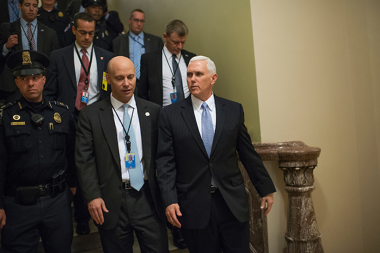 UNITED STATES - JANUARY 24: Vice President Mike Pence, right, leaves the Republican Senate Policy luncheon in the Capitol, January 24, 2017. (Photo By Tom Williams/CQ Roll Call)