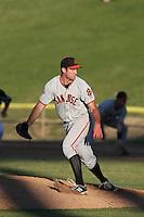Christian Jones (14) of the San Jose Giants pitches during a game against the High Desert Mavericks at Mavericks Stadium on June 14, 2015 in Adelanto, California. High Desert defeated San Jose, 7-5. (Larry Goren/Four Seam Images)