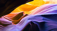 Violent waves of colorful desert sandstone create a photogenic landscape unique to Antelope Canyon near Page and Lake Powell in Arizona