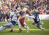 Washington Redskins running back Kapri Bibbs (46) eludes an attempted tackle by Dallas Cowboys linebacker Jaylon Smith (54) as he runs for a touchdown in the first quarter at FedEx Field in Landover, Maryland on Sunday, October 21, 2018.<br /> Credit: Ron Sachs / CNP