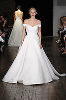 """Model walks runway in a """"Darling"""" bridal gown from the Alyne by Rita Vinieris Fall 2017 collection on October 7th, 2016 during New York Bridal Fashion Week."""