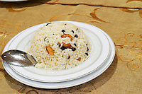 Rice with nuts and corints raisins. Efendi Efendy traditional Turkish and Ottoman Restaurant, The Block, Tirana. Albania, Balkan, Europe.