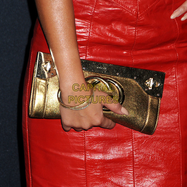 ADRIENNE BAILON's hand  .Gucci and Rocnation Pre-Grammy Brunch held at Soho House, West Hollywood, California, USA, .12th February 2011..detail hand gucci  gold clutch bag .CAP/ADM/BP.©Byron Purvis/AdMedia/Capital Pictures.