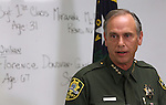 Carson City Sheriff Ken Furlong holds a press conference Wednesday morning, Sept. 7, 2011 updating details on yesterday's shooting spree at a Carson City, Nev. IHOP restaurant that left five dead and seven others wounded. The names of the people killed were listed on the board behind Furlong. (AP Photo/Cathleen Allison)