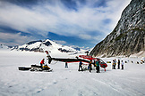 ALASKA, Juneau, Helicopter Dogsled Tour flies you over the Taku Glacier to the HeliMush dog camp at Guardian Mountain above the Taku Glacier, Juneau Ice Field