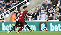 Liverpool's Alex Oxlade-Chamberlain under pressure from Newcastle United's Christian Atsu<br /> <br /> Photographer Rich Linley/CameraSport<br /> <br /> The Premier League -  Newcastle United v Liverpool - Sunday 1st October 2017 - St James' Park - Newcastle<br /> <br /> World Copyright &copy; 2017 CameraSport. All rights reserved. 43 Linden Ave. Countesthorpe. Leicester. England. LE8 5PG - Tel: +44 (0) 116 277 4147 - admin@camerasport.com - www.camerasport.com