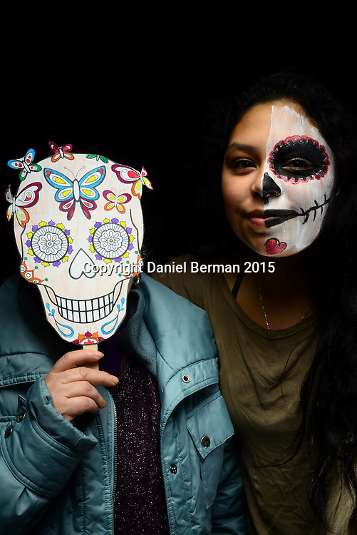 Visitors to El Centro de La Raza take part in Dia de Los Muertos activities and events Nov. 2, 2015 in Beacon Hill, Seattle. Photo by Daniel Berman/www.bermanphotos.com