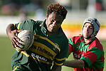 S. Lutumailagi attempts to evade the clutches of A. Morgan. Counties Manukau Premier Club Rugby, Pukekohe v Waiuku  played at the Colin Lawrie field, on the 3rd of 2006.Pukekohe won 36 - 14