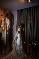 CAPE TOWN, SOUTH AFRICA - JULY 26: A model stands in a wedding dressing room during an installation show at the new Klûk CGDT flagship store during Mercedes-Benz Fashion Week on July 26, 2014, in Cape Town, South Africa. Klûk CGDT, created by the designers Malcolm KLûK and Christiaan Gabriel Du Toit. The elite of Cape Town came out for the launch of the store and the late night party. (Photo by Per-Anders Pettersson)
