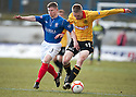 Cowdenbeath's Marc McKenzie and Thistle's Chris Erskine challenge for the ball.
