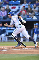 Asheville Tourists shortstop Ryan Vilade (4) runs to first base during a game against the Columbia Fireflies at McCormick Field on April 13, 2018 in Asheville, North Carolina. The Tourists defeated the Fireflies 5-1. (Tony Farlow/Four Seam Images)