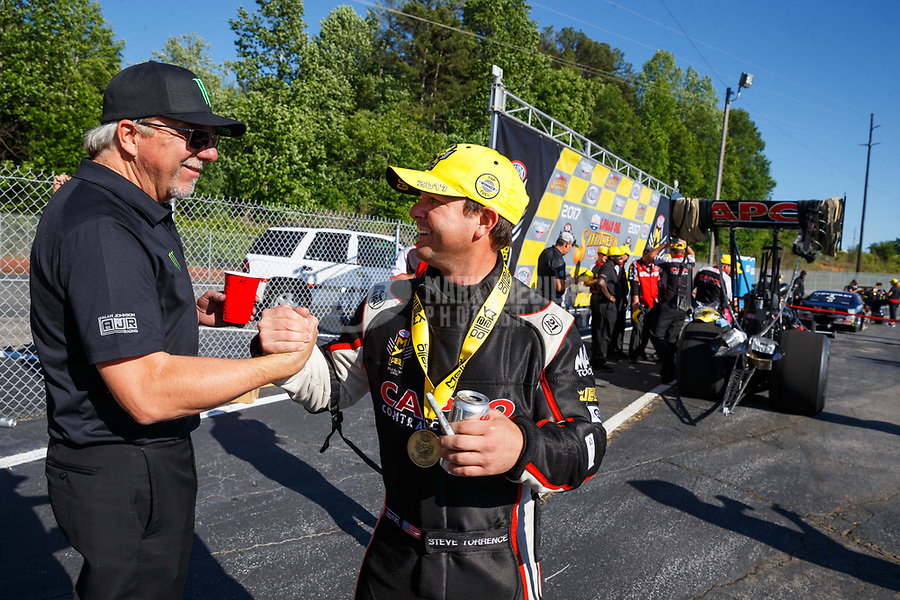 May 7, 2017; Commerce, GA, USA; NHRA top fuel driver Steve Torrence (right) celebrates with tuner Alan Johnson after winning the Southern Nationals at Atlanta Dragway. Mandatory Credit: Mark J. Rebilas-USA TODAY Sports